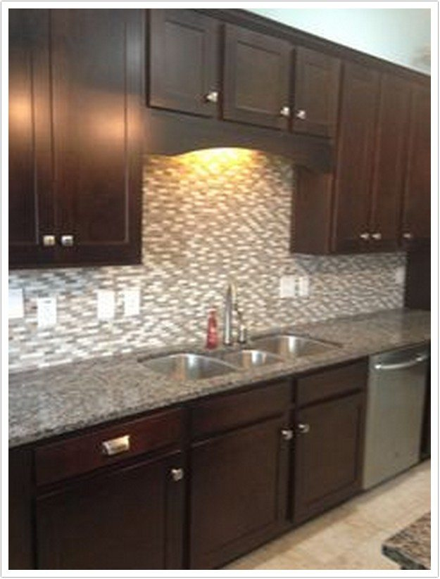 New Caledonia Granite on dark oak kitchen cabinets