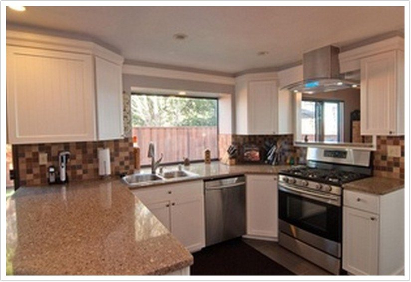 Toasted almond kitchen cabinets kitchen cabinets for Almond colored kitchen cabinets