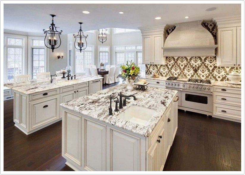 Kitchen With White Cabinets And Neutral Granite Countertop